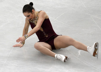 Canada's Osmond falls during the women's free program at the ISU World Figure Skating Championships in Saitama