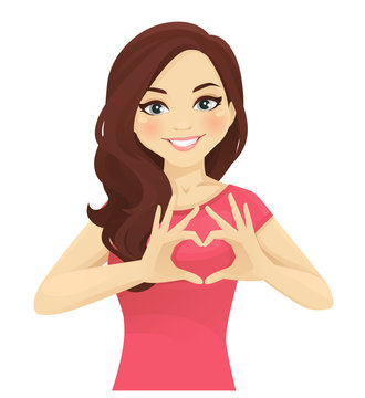 Woman making heart shape with hands isolated.