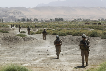 U.S. Marines from 1st Light Armoured Reconnaisance Battalion, Alpha Company patrol an area in Taghaz village in Helmand