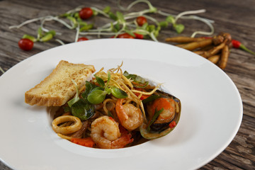Spaghetti with seafood on wooden  background