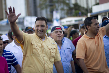 Opposition presidential candidate and Zulia's state governor Pablo Perez waves to supporters during a rally in Caracas