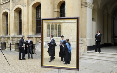 File photograph shows graduates queueing to have their photograph taken after a graduation ceremony at Oxford University in England