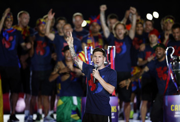 Barcelona's Messi speaks to supporters during celebration parade in Barcelona