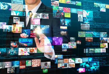 businessman touching  mix technology image