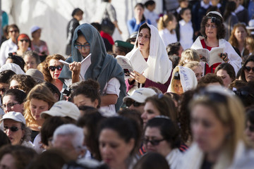 """Members of """"Women of the Wall"""" group wear prayer shawls during a monthly prayer session at the Western Wall in Jerusalem's Old City"""