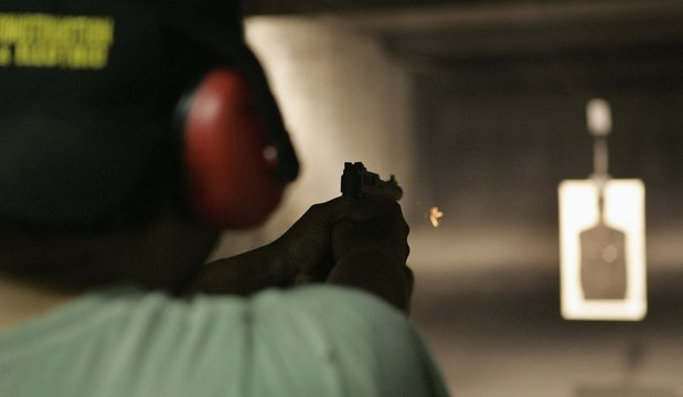 File photo of Jesse LaFlores firing a small .22 calibre handgun at Rink's Gun and Sport in the Chicago suburb of Lockport, Illinois