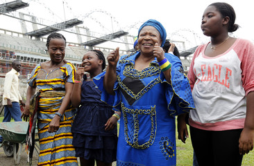 Gabon musician, former First Lady and mother of the current President of Gabon Ondimba, Dabany and members of her family cheer members of their national soccer team at the Omnisport stadium in Libreville