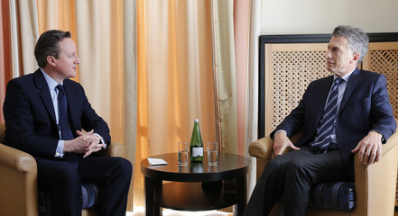 British Prime Minister Cameron speaks with Argentina's President Macri as they meet in hotel Belvedere during the annual meeting of the World Economic Forum (WEF) in Davos
