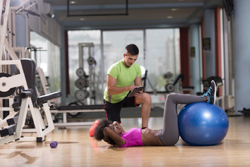 pilates  workout with personal trainer at gym