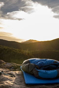 sleeping bag and pad laid out on top of a mountain