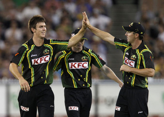 Mitchell Marsh of Australia celebrates with compatriot Shaun Marsh after taking the wicket of India's Kohli during their T20 International series cricket match in Melbourne