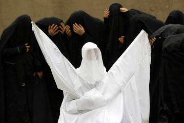 Shi'ite women take part in a re-enactment of the battle of Kerbala during an Ashura procession in Istanbul