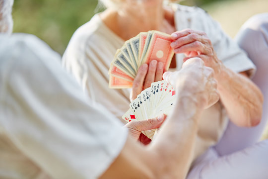 Two retired seniors playing cards as a hobby