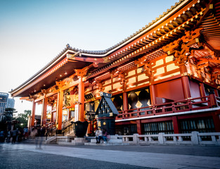 Tourists are entering the Sensoji shrine main building.