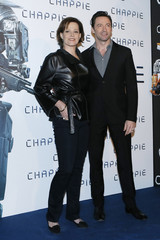 "Actors Jackman and Weaver pose during a photo call for the film ""Chappie"" by director Neill Blomkamp in Paris"