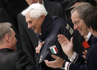 Pope Benedict XVI wears a jacket of Italian civil protection department as Guido Bertolaso, the head of the Italian civil protection department, applauds in the Vatican