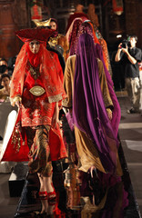Models present batik Muslim dresses by Indonesian designer Ghea Panggabean during Islamic Fashion Festival in Jakarta