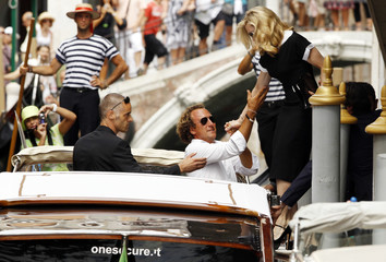 """U.S. pop star Madonna, director of movie """"W.E."""", leaves by speedboat to her hotel in Venice during the 68th Venice Film Festival"""