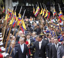 Chile's President Sebastian Pinera walks with Ecuador's President Rafael Correa outside Carondelet Palace in Quito