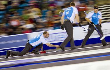 Team Quebec skip Jean-Michel Menard delivers a stone against team Manitoba during the 2014 Tim Hortons Brier curling championships in Kamloops