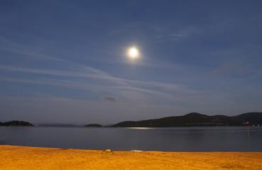 Long exposure of full moon over Aegean sea at Turkbuku village in Bodrum peninsula in southwestern Turkey in 2016 summer.