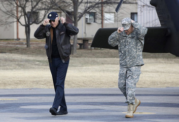 U.S. Vice President Biden and commander of combined U.S.-South Korea forces U.S. Army General Scaparrotti wear their caps upon arrival at the DMZ, the military border separating the two Koreas, in Panmunjom