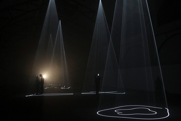"""People look at light installation by British artist McCall during exhibition """"Five Minutes of Pure Sculpture"""" in Berlin"""