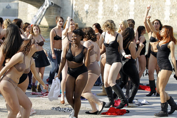 """Women in their underwear dance during a flash-mob named """"beautiful naked"""" organised by French TV M6 near the Seine river in Paris"""