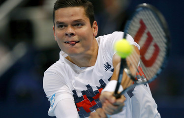 Canada's Raonic returns the ball during his match against Johnson of the U.S. at the Swiss Indoors ATP tennis tournament in Basel