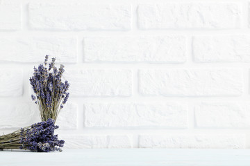 Bunch of lavender flowers on the brick wall background