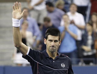 Novak Djokovic of Serbia waves to the crowd after defeating Nikolay Davydenko of Russia in their match at the U.S. Open tennis tournament in New York
