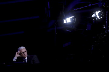 CNN anchor Cooper watches the Democratic U.S. presidential candidates debate between Clinton and Sanders hosted by Univision News and the Washington Post and co-broadcast with CNN in Kendall