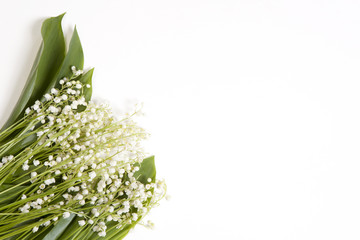 Lilly of the valley flowers and leaves bouquet isolated on a white background. Selective focus