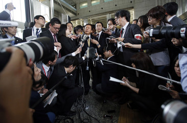 Tokyo Governor Naoki Inose is surrounded by media as he speaks to reporters at Tokyo Metropolitan Government headquarters in Tokyo