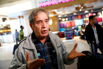 Hossein Khoshbakhty speaks during an interview about his Iranian brother, a U.S. Green Card holder effected by the travel ban at Los Angeles International Airport (LAX) in Los Angeles, California