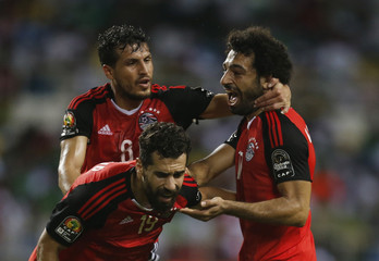 Egypt's Mohamed Salah celebrates scoring their first goal with team mates