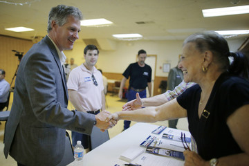 Scott Brown, a Republican candidate for the U.S. Senate, greets voters before a town hall campaign stop at a VFW post in Hudson