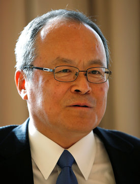 Mitsubishi Corporation President and CEO Kakiuchi adjusts his eye glasses during an interview with Reuters in Tokyo