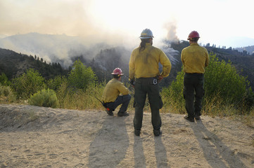 Supervisors of hotshot crews observe the fires on Grimes Pass, part of the Whiskey Complex fire near Garden Valley, Idaho