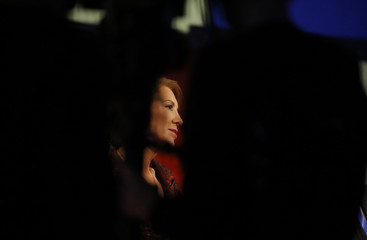 Republican U.S. presidential candidate and former HP CEO Carly Fiorina is framed in the silhouettes of television cameramen and technicians during a forum for the lower polling candidates in Des Moines