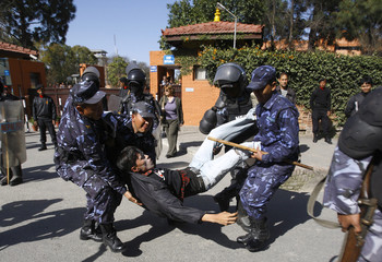 "A Tibetan activist is detained by Nepalese police officers during their protest outside the UN office in Nepal on the third day of Tibetan New Year or ""Losar"" in Kathmandu"
