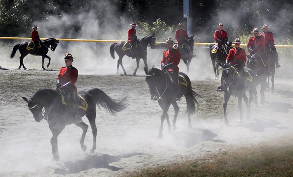 Members of the Royal Canadian Mounted Police practice on a baseball diamond prior to a performance in North Vancouver