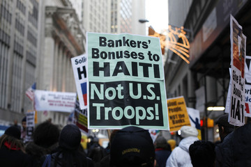 People demonstrate against Wall Street bonuses and bailouts, outside the New York Stock Exchange