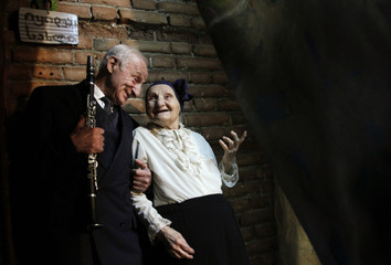 "Marika Sikharulidze and Vakhtang Goguadze wait backstage during the ""Super Grandmother and Super Grandfather"" contest in Tbilisi"
