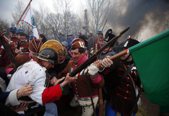 People dressed as Hungarian Hussars and Austrian soldiers of the Habsburg dynasty take part in the re-enactment of the battle of Tapiobicske