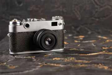 The old rangefinder camera on Lava background.