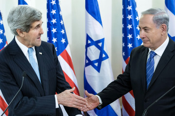 U.S. Secretary of State Kerry and Israeli Prime Minister Netanyahu shake hands before a meeting at the Prime Minister's Office in Jerusalem