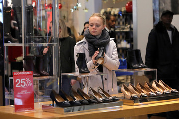A woman looks at shoes during early opening for Black Friday sales at Macy's Herald Square in Manhattan, New York, U.S.