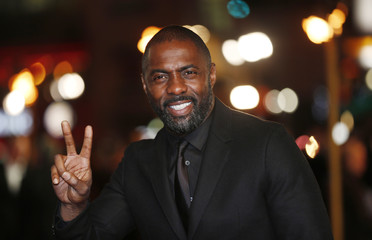 "Actor Elba gestures as he arrives for the world premiere of ""Les Miserables"" in London"