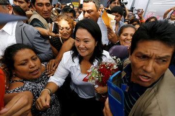 Fujimori greets supporters after a meeting with local leaders in San Juan de Lurigancho in Lima